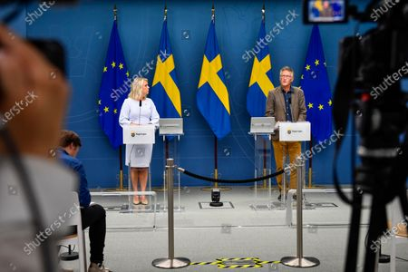 Sweden's Minister for Health and Social Affairs Lena Hallengren (L) and State epidemiologist Anders Tegnell of the Public Health Agency speak during a news conference on updated disease.