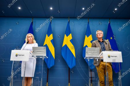 Sweden's Minister for Health and Social Affairs Lena Hallengren (L) and State epidemiologist Anders Tegnell of the Public Health Agency speak during a news conference on updated recommendations to curb the spread of the coronavirus disease.