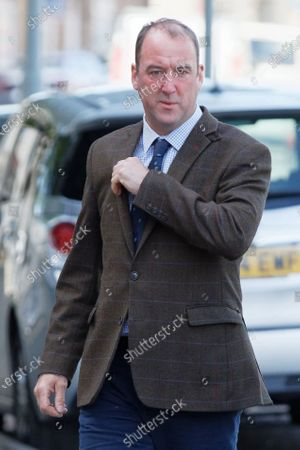 Graham Hassall, the husband of Sarah Hassall, arrives at Swansea Crown Court