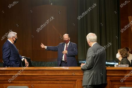 United States Senator Chris Coons (Democrat of Delaware), center, speaks to US Senator Bob Menendez (Democrat of New Jersey), US Senator Rob Portman (Republican of Ohio) and US Senator Jeanne Shaheen (Democrat of New Hampshire) during a break in a Senate Foreign Relations Committee hearing to discuss the Trump administration's FY 2021 budget request for the State Department.