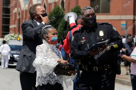 Xernona Clayton, the god mother of Rep. John Lewis' son John-Miles Lewis, is seen after the funeral for Rep. John Lewis at Ebenezer Baptist Church, in Atlanta. Lewis, who carried the struggle against racial discrimination from Southern battlegrounds of the 1960s to the halls of Congress, died Friday, July 17, 2020