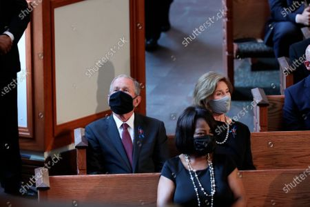 Former President George W. Bush and his wife Laura Bush are seated for the funeral service for the late Rep. John Lewis, D-Ga., at Ebenezer Baptist Church in Atlanta