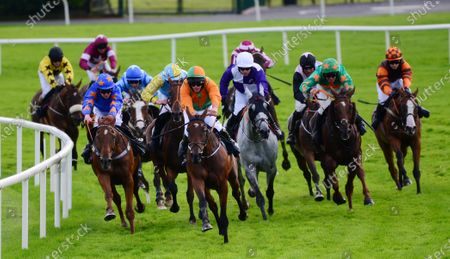 Galway THE TRIGGER & Mark Walsh (left blue and orange) win the Open gate Pure Brew Handicap Hurdle from VICTORIA BAY & Rob James (right green & orange)