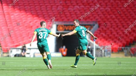 Cal Roberts celebrate pulling a goal back for Notts with his skipper Michael Doyle.