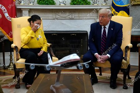 Slain Army Spc. Vanessa Guillen's mother Gloria Guillen wipes her eyes while speaking with President Donald Trump in the Oval Office of the White House, in Washington