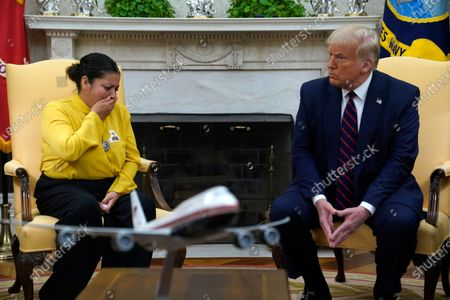 Army Spc. Vanessa Guillen's mother Gloria Guillen, left, tears up as she meets with President Donald Trump in the Oval Office of the White House, in Washington
