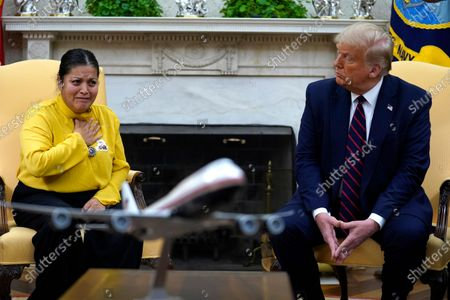 Army Spc. Vanessa Guillen's mother Gloria Guillen, left, speaks as she meets with President Donald Trump in the Oval Office of the White House, in Washington