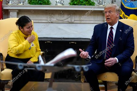 Army Spc. Vanessa Guillen's mother Gloria Guillen, left, listens as she meets with President Donald Trump in the Oval Office of the White House, in Washington