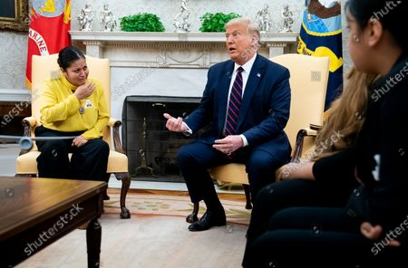 US President Donald Trump (C) talks with the mother of murdered Fort Hood soldier Vanessa Guillen, Gloria Gullen (L), during a meeting with the family in the Oval Office at the White House, in Washington, DC, USA, 30 July 2020. Vanessa Guillen was a 20-year-old US Army soldier who authorities believe was killed on 22 April 2020 inside a Fort Hood, Texas, armory.