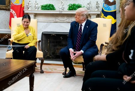 US President Donald Trump (C) looks on as the mother of murdered Fort Hood soldier Vanessa Guillen, Gloria Gullen (L) talks about her daughter's murder, during a meeting with the family in the Oval Office at the White House, in Washington, DC, USA, 30 July 2020. Vanessa Guillen was a 20-year-old US Army soldier who authorities believe was killed on 22 April 2020 inside a Fort Hood, Texas, armory.