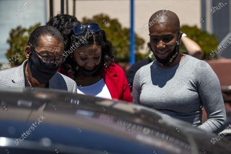 US actress Tiffany Haddish (R) and Los Angeles City Councilmember Herb Wesson (L) distribute computers to students in foster care during a drive-thru giveaway amid the coronavirus pandemic in Los Angeles, California, USA, 30 July 2020. The computers are donated by Wesson's 'OurCycleLA' project, a digital inclusion program designed to bridge the digital divide in low-income households in Los Angeles and other marginalized communities.