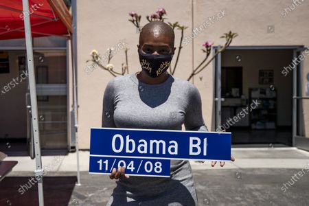 US actress Tiffany Haddish poses for the photographers holding a sign reading 'Obama Bl 11/04/08' prior to a distribution of computers to students in foster care during a drive-thru giveaway amid the coronavirus pandemic in Los Angeles, California, USA, 30 July 2020. The computers are donated by Wesson's 'OurCycleLA' project, a digital inclusion program designed to bridge the digital divide in low-income households in Los Angeles and other marginalized communities.