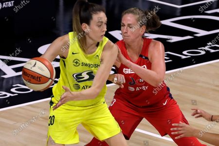 Stock Image of Washington Mystics forward Emma Meesseman, right, (33) blocks Seattle Storm forward Breanna Stewart (30) for going to the basket during the first half of a WNBA basketball game, in Bradenton, Fla