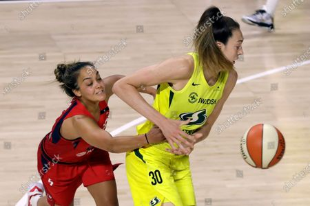 Washington Mystics guard Leilani Mitchell (5) knocks the ball away from Seattle Storm forward Breanna Stewart (30) during the second half of a WNBA basketball game, in Bradenton, Fla
