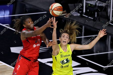Washington Mystics forward Myisha Hines-Allen (2) goes up for a shot over Seattle Storm forward Breanna Stewart (30) during the first half of a WNBA basketball game, in Bradenton, Fla