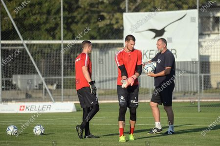 Stock Image of Goalie Coach Paolo Cesari talks with Alexis Regg and Raphael Spiegel
