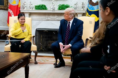 Stock Image of United States President Donald J. Trump looks on as the mother of murdered Fort Hood soldier Vanessa Guillen, Gloria Gullen, talks about her daughter's murder during a meeting with the family in the Oval Office of the White House in Washington, DC,.