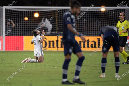 Philadelphia Union midfielder Jose Andres Martinez (8) kneels after getting a win as Sporting Kansas City players react in an MLS soccer match, in Kissimmee, Fla