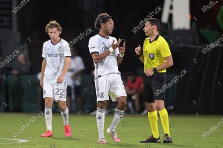Philadelphia Union midfielder Jose Andres Martinez (8) argues with an official after receiving a yellow card during the first half of an MLS soccer match against Sporting Kansas City, in Kissimmee, Fla