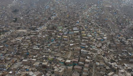 The San Hilario neighborhood of the San Juan de Lurigancho district is seen from above, on the outskirts of Lima, Peru