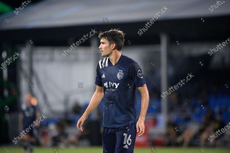 Sporting Kansas City midfielder Graham Smith (16) follows a play during the second half of an MLS soccer match against the Philadelphia Union, in Kissimmee, Fla