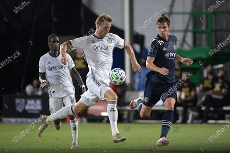 Philadelphia Union forward Kacper Przybylko, center, competes with Sporting Kansas City midfielder Graham Smith (16) for a ball during the second half of an MLS soccer match, in Kissimmee, Fla