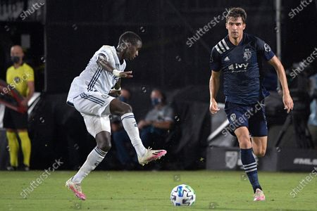 Philadelphia Union midfielder Jamiro Monteiro, left, controls a pass in front of Sporting Kansas City midfielder Graham Smith, right, during the second half of an MLS soccer match, in Kissimmee, Fla