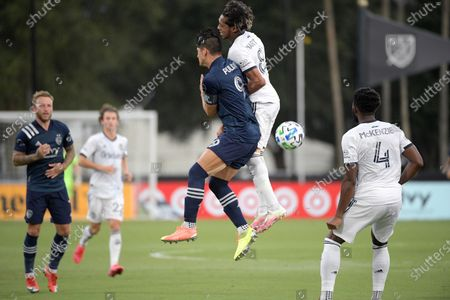 Sporting Kansas City forward Alan Pulido (9) and Philadelphia Union midfielder Jose Andres Martinez (8) during the first half of an MLS soccer match, in Kissimmee, Fla