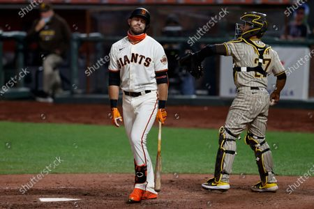 San Francisco Giants Evan Longoria (L) reacts after striking out with the bases loaded by San Diego Padres relief pitcher Drew Pomeranz as San Diego Padres catcher Francisco Mejia (R) throws the ball back to Pomeranz during the seventh inning of their MLB game at Oracle Park, in San Francisco, California, USA, 30 July 2020. The start of the season was delayed due to the coronavirus pandemic and games are being held behind closed doors.