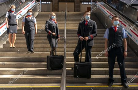 Stock Picture of Employees of the German Railway (Deutsche Bahn) wearing the old uniforms at the Railway station in Stuttgart, Germany, 31 July 2020. According to Deutsche Bahn, around 43,000 employees with customer contact will wear the new corporate clothing from 01 August 2020. The German designer Guido Maria Kretschmer had designed the collection of 80 individual pieces in consultation with German Railway employees.