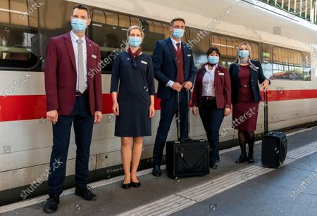 Employees of the German Railway (Deutsche Bahn) present the new uniforms at the Railway station in Stuttgart, Germany, 31 July 2020. According to Deutsche Bahn, around 43,000 employees with customer contact will wear the new corporate clothing from 01 August 2020. The German designer Guido Maria Kretschmer had designed the collection of 80 individual pieces in consultation with German Railway employees.