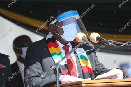 Zimbabwean President Emmerson Mnangagwa addresses mourners at the burial of Zimbabwean minister Perence Shiri, who died of Covid-19, during his burial in Harare, . Zimbabwes capital, Harare, was deserted Friday, as security agents vigorously enforced the countrys lockdown amidst planned protests