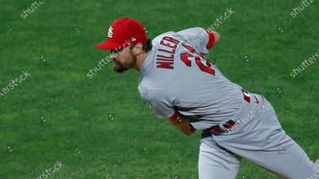 St. Louis Cardinals pitcher Andrew Miller throws against the Minnesota Twins in a baseball game, in Minneapolis