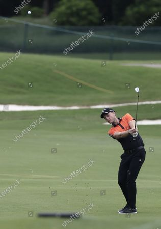 Danny Willett of England hits from the fairway on the twelfth hole during the second round of the World Golf Championships-FedEx St. Jude Invitational golf tournament at TPC Southwind in Memphis, Tennessee, USA, 31 July 2020. Competition runs from 30 July through 02 August without fans in attendance.