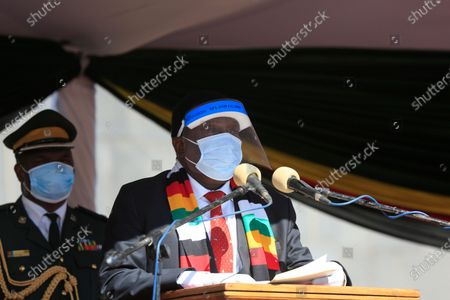 Zimbabwean President Emmerson Mnangagwa wears a face shield and a face mask as he gives a speech during the burial of the late Zimbabwe minister of Agriculture, Perence Shiri at the National Heroes Acre in Harare, Zimbabwe, 31 July 2020. The minister died with covid-19 on 29th July 2020.