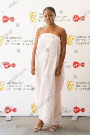 Actress Nina Toussaint White poses for photographers as they arrive for the British Academy Television Awards at the Television Centre in west London