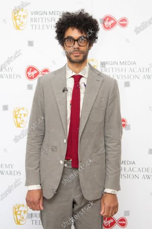 Actor Richard Ayoade poses for photographers as they arrive for the British Academy Television Awards at the Television Centre in west London