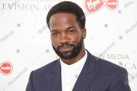 Actor Sope Dirisu poses for photographers as they arrive for the British Academy Television Awards at the Television Centre in west London