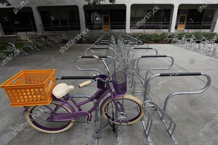 Stock Photo of Lone bike is parked outside Lee Hall as college students begin moving in for the fall semester at N.C. State University in Raleigh, N.C
