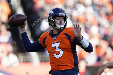 """Denver Broncos quarterback Drew Lock throws a pass during the first half of an NFL football game against the Oakland Raiders in Denver. John Elway says expectations for Lock this season are """"definitely tempered"""" by the effects of the coronavirus that scuttled the regular offseason and all preseason games"""
