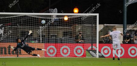 Orlando City goalkeeper Pedro Gallese (1) blocks a shot by Los Angeles FC defender Jordan Harvey (2) during a shootout in an MLS soccer match, in Orlando, Fla