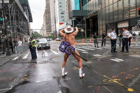 Naked Cowboy poses before peaceful rally Take your knee off our necks on 5th Avenue in front of Trump tower. The rally was organized by Crisis Action Center. There were about hundred participants. There were daily protests in New York and around the country following death of George Floyd while in custody of Minneapolis police.