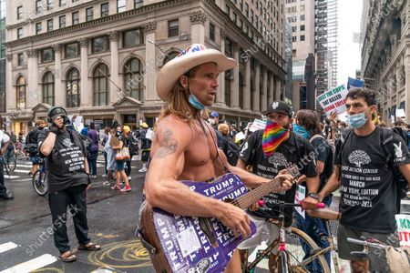 Protesters confront Naked Cowboy at peaceful rally Take your knee off our necks on 5th Avenue in front of Trump tower. The rally was organized by Crisis Action Center. There were about hundred participants. There were daily protests in New York and around the country following death of George Floyd while in custody of Minneapolis police.