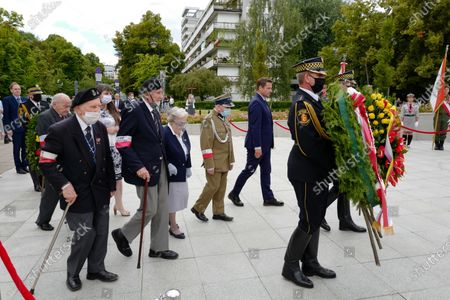 Mayor of Warsaw Rafal Trzaskowski (2-R) attends a wreath-laying ceremony at the Monument to the Polish Underground State on the occasion of the 76th anniversary of the Warsaw Uprising, in Warsaw, Poland, 01 August 2020. Poland celebrates the 76th anniversary of the Warsaw Uprising which started on 01 August 1944 as the biggest resistance operation in Nazi-occupied Europe. Initially intended to last several days, it continued for over two months before being suppressed by the Germans. The uprising claimed the lives of about 18,000 insurgents and around 180,000 civilians. After the uprising failed, the Nazis expelled the remaining inhabitants from the city and methodically blew it up, destroying it almost completely.
