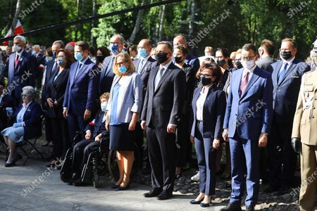 Polish President Andrzej Duda (4-R), Polish sejm speaker Elzbieta Witek (3-R), Polish Prime Minister Mateusz Morawiecki (2-R) and Mayor of Warsaw Rafal Trzaskowski (3-L) during the ceremony commemorating the 76th anniversary of the Warsaw Uprising in front of the Gloria Victis monument at the Powazki Military Cemetery in Warsaw,  Poland, 01 August, 2020. The Warsaw Uprising broke out on 01 August 1944 as the biggest resistance operation in Nazi-occupied Europe. Initially intended to last several days, it continued for over two months before being suppressed by the Germans. The uprising claimed the lives of 18,000 insurgents and around 180,000 civilians. After the failure of the uprising, the Nazis expelled the remaining inhabitants from the city and methodically blew it up, destroying it almost completely.