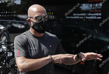 Stock Photo of Ineos team general manager Dave Brailsford prepares prior to the 1st stage of the La Route d'Occitanie La Depeche du Midi cycling race over 187km between Saint-Affrique and Cazouls-les-Beziers, France, 01 August 2020.