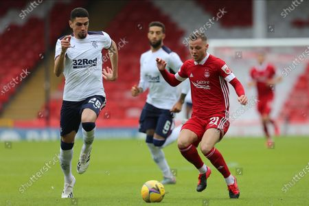Aberdeen forward Bruce Anderson (21)gets the ball ahead of Leon Balogun (26) of Rangers during the Ladbrokes Scottish Premiership match between Aberdeen and Rangers at Pittodrie Stadium, Aberdeen