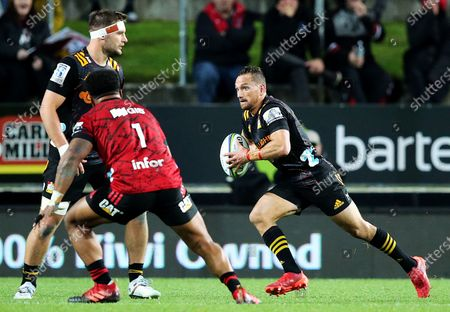 Chiefs vs Crusaders. Chiefs' Aaron Cruden comes up against George Bower of Crusaders