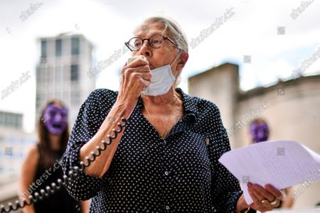 British Actress Vanessa Redgrave gives a speech as she joins the theatre workers protest outside the National Theatre, against the mass redundancies of low-paid art jobs due to the Coronavirus outbreak, in London, . Prime Minister Boris Johnson put some planned measures to ease the U.K.'s lockdown on hold Friday, saying the number of new coronavirus cases in the country is on the rise for the first time since May. He called off plans to allow venues, including casinos, bowling alleys and skating rinks, to open from Saturday, Aug. 1