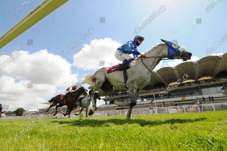 Ebraz and Maxime Guyon win the Qatar International Stakes at Goodwood against empty stands.